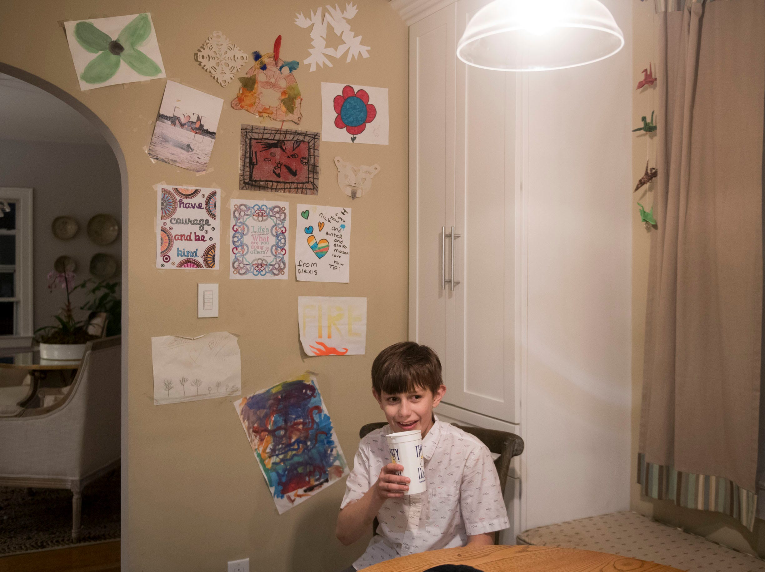 Blake Hall and his siblings creative projects decorate part of the wall in the kitchen.