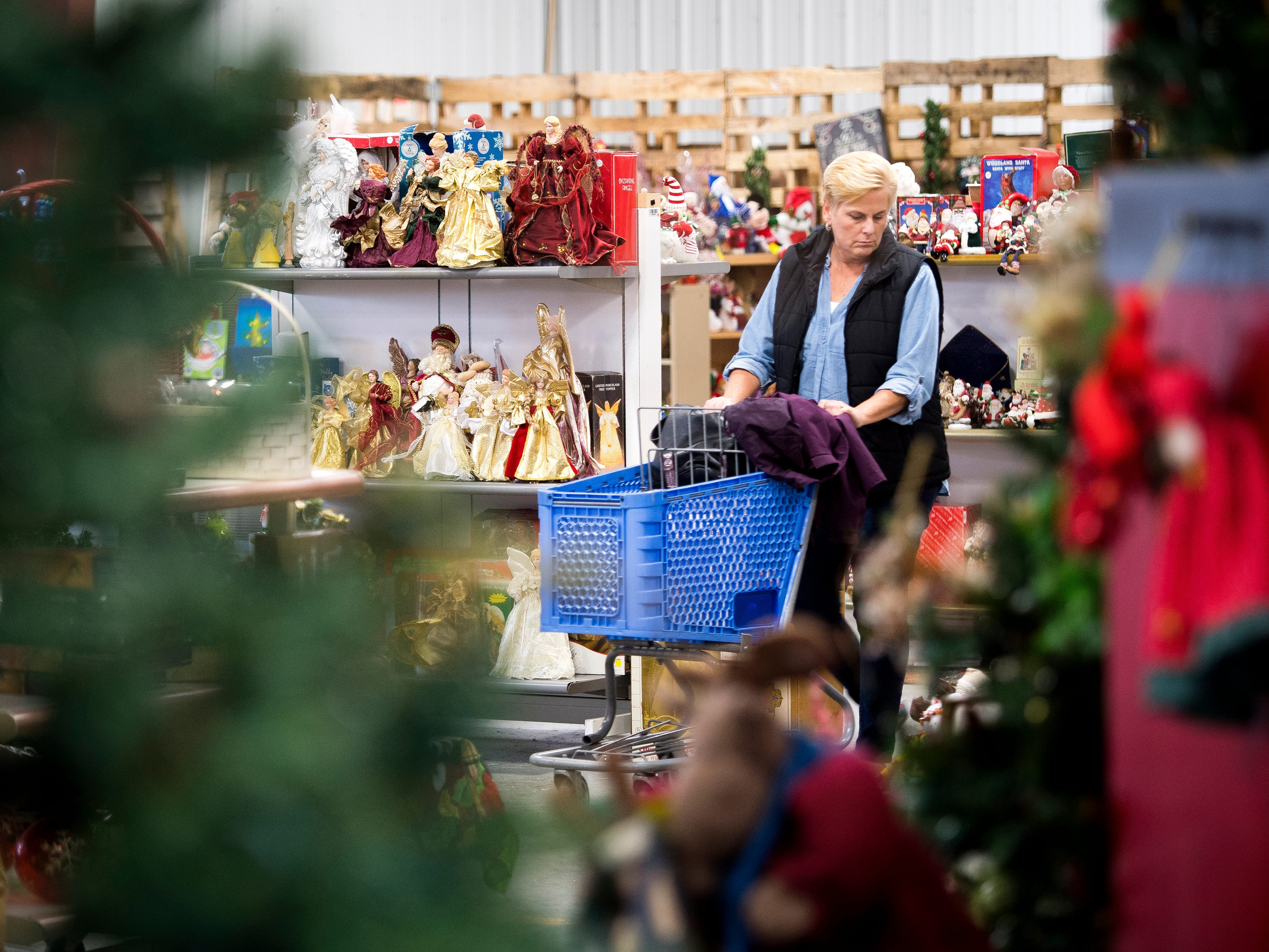 A customer browses Christmas decorations for sale at the KARM Christmas Store located at 9629 Parkside Drive in Knoxville on Tuesday, November 13, 2018.
