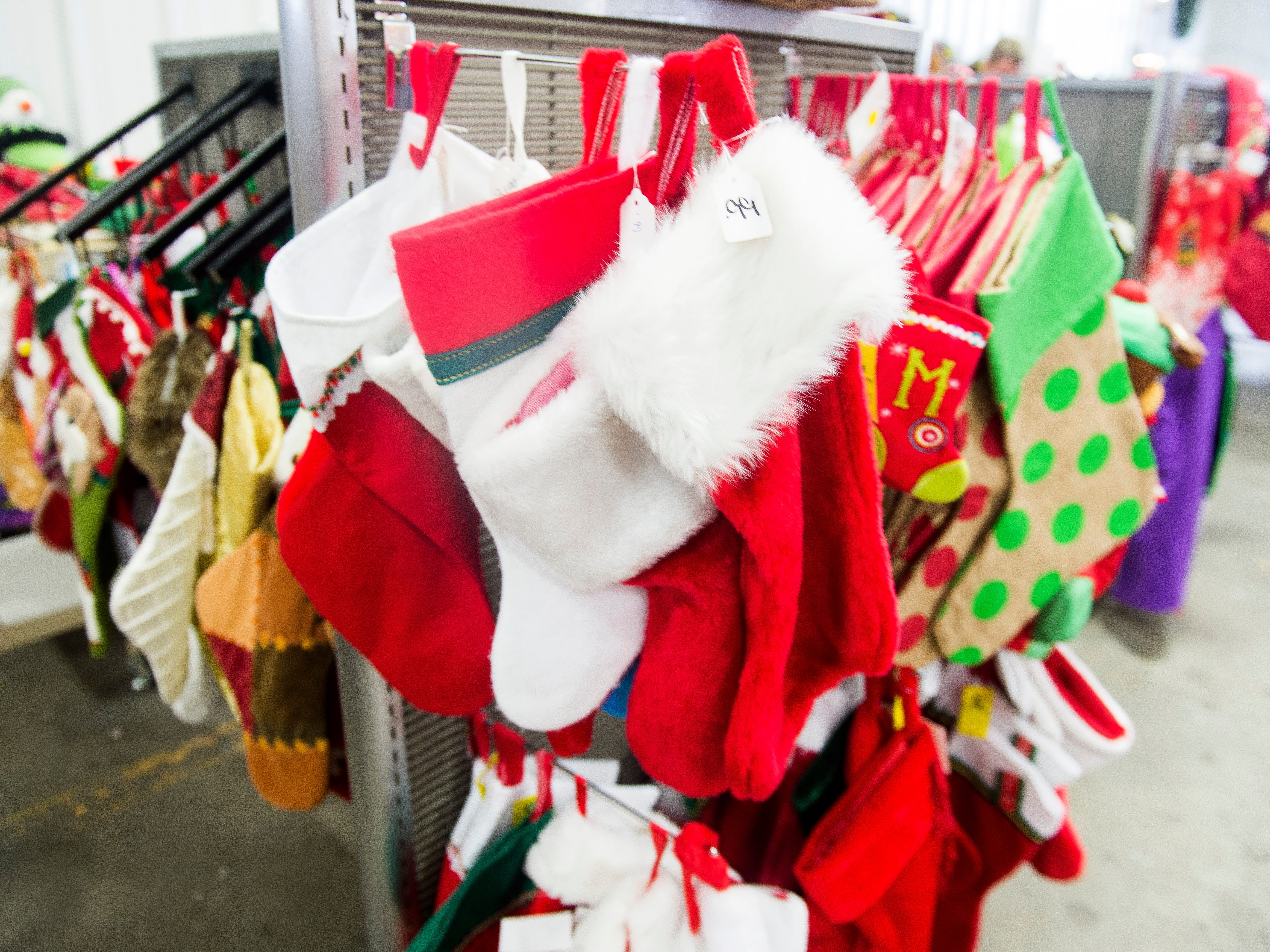 Christmas stockings for sale at the KARM Christmas Store located at 9629 Parkside Drive in Knoxville on Tuesday, November 13, 2018.
