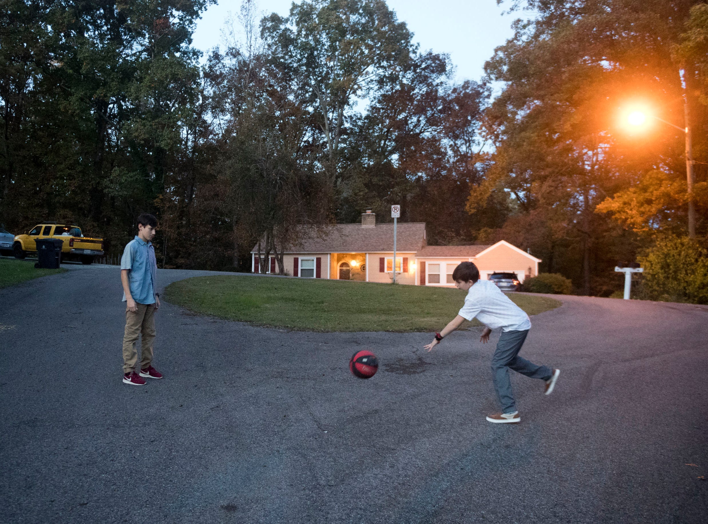 Nick and Blake Hall practice basketball outside their home. The family lives in South Knoxville.