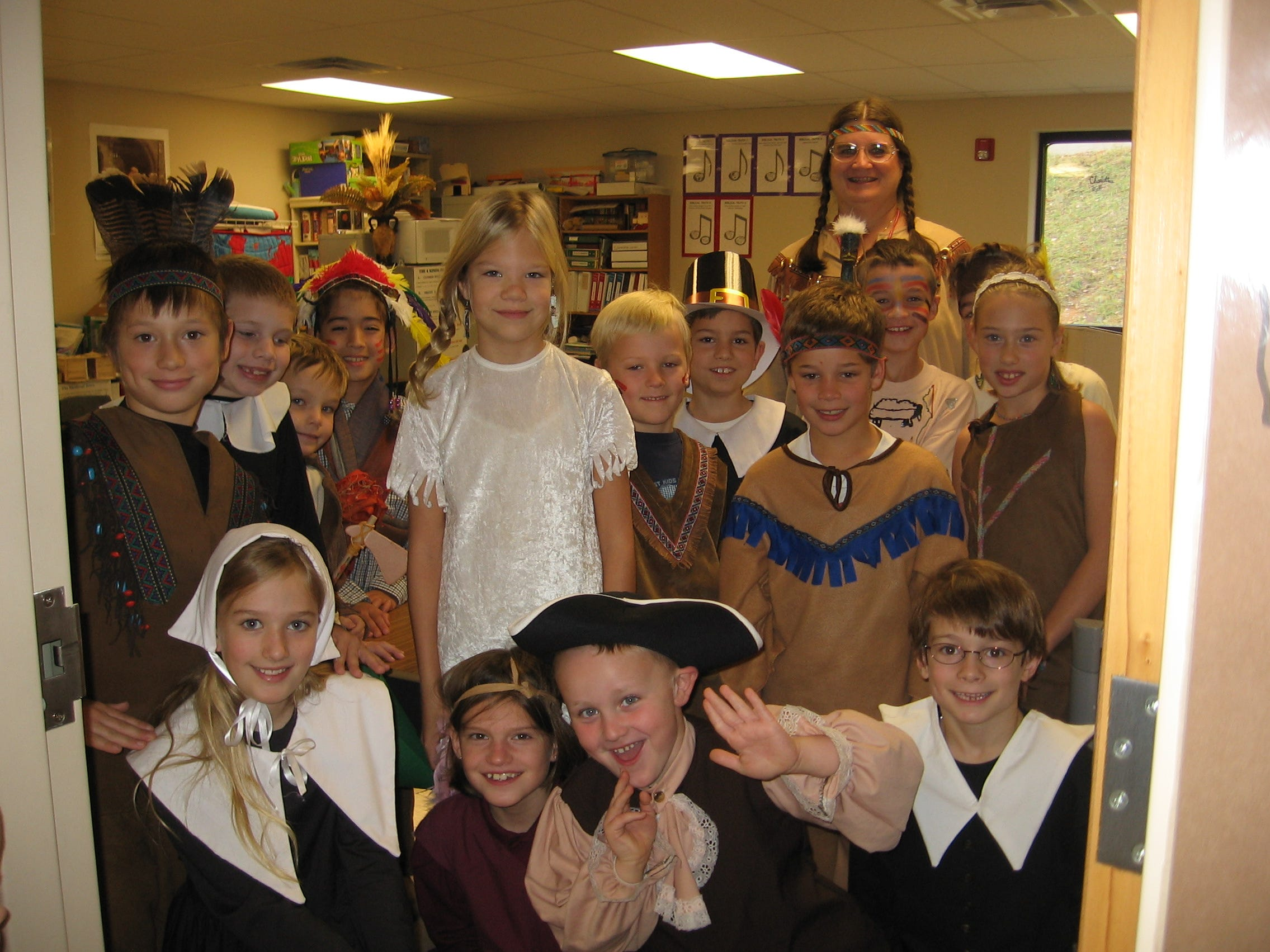 Paideia Academy students dressed up as pilgrims and Indians to celebrate Thanksgiving at a school event  Nov. 19