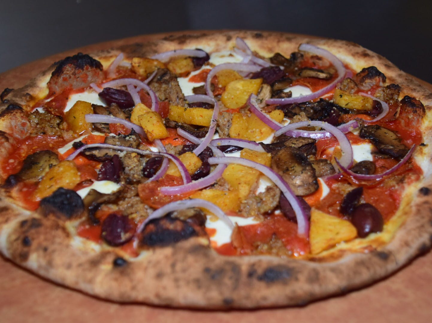While established pizza recipes are named after famous boxers, but custom orders are always welcome at Hard Knox Pizza.