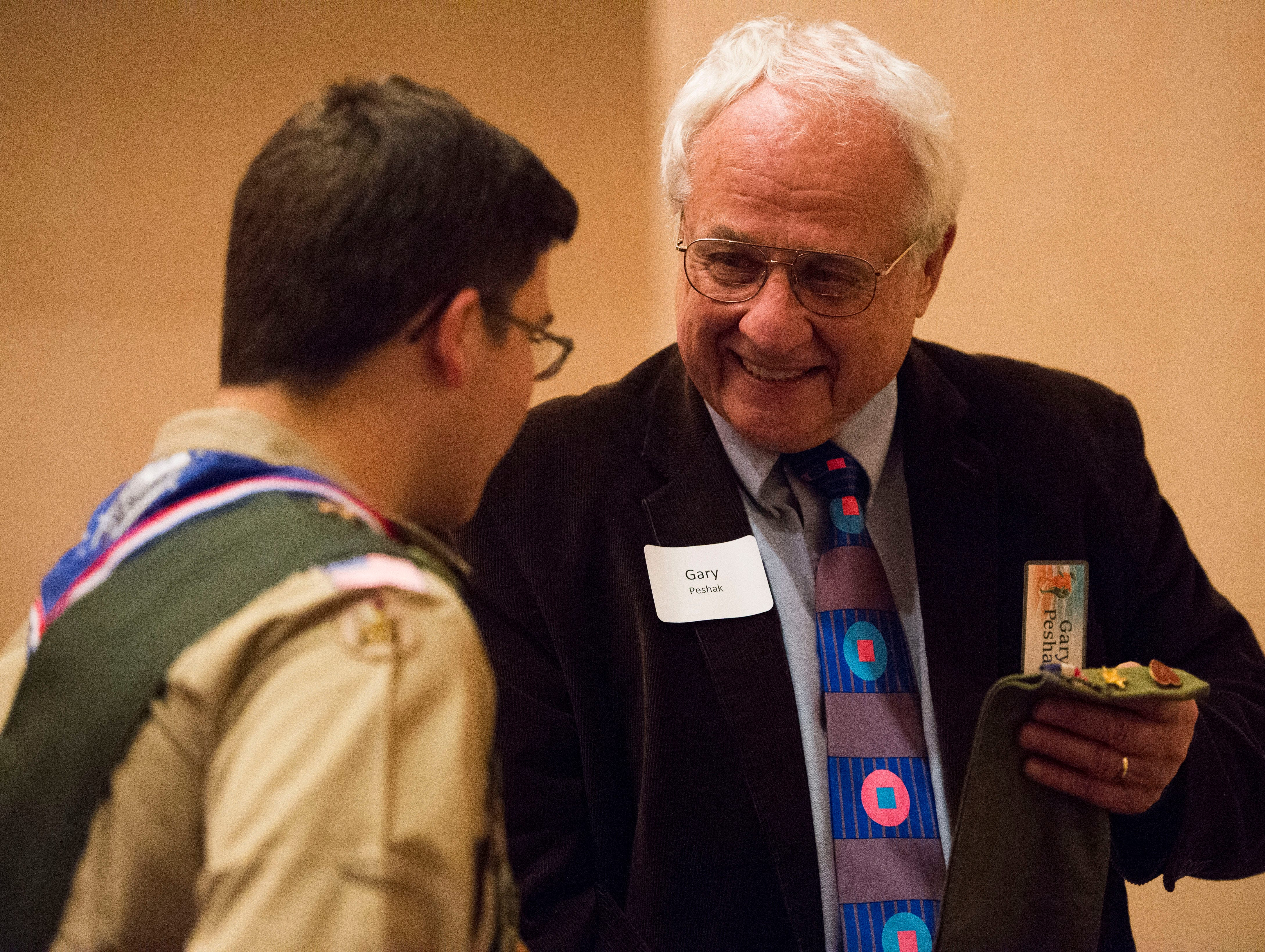 At right Gary Peshak looks at old scouting paraphernalia with a scout at the 2018 Eagle Scout gathering held at Hotel Knoxville Thursday, Nov. 15, 2018. Sam Beall received the Silver Beaver award at the event, which is the highest award in scouting.