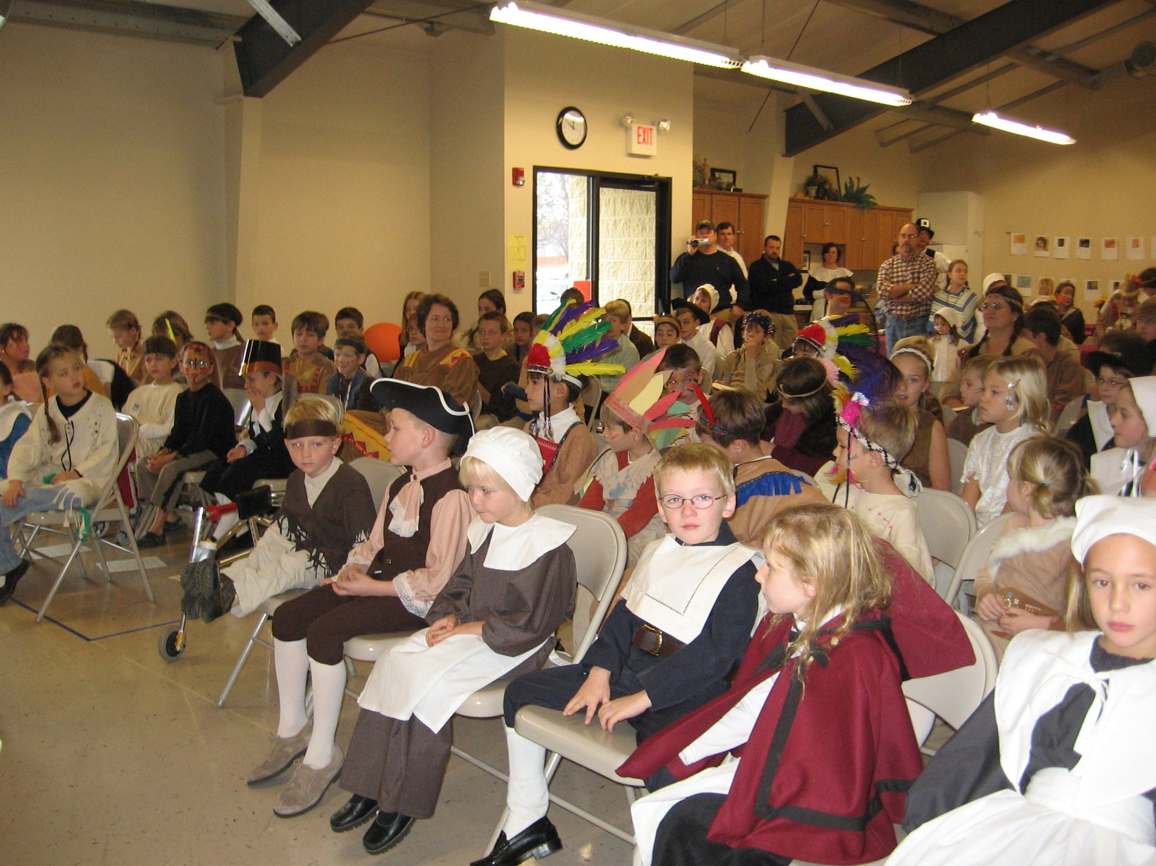 Rows upon rows of little pilgrims and Indians wait for a Thanksgiving presentation at Paideia Academy Nov. 19.