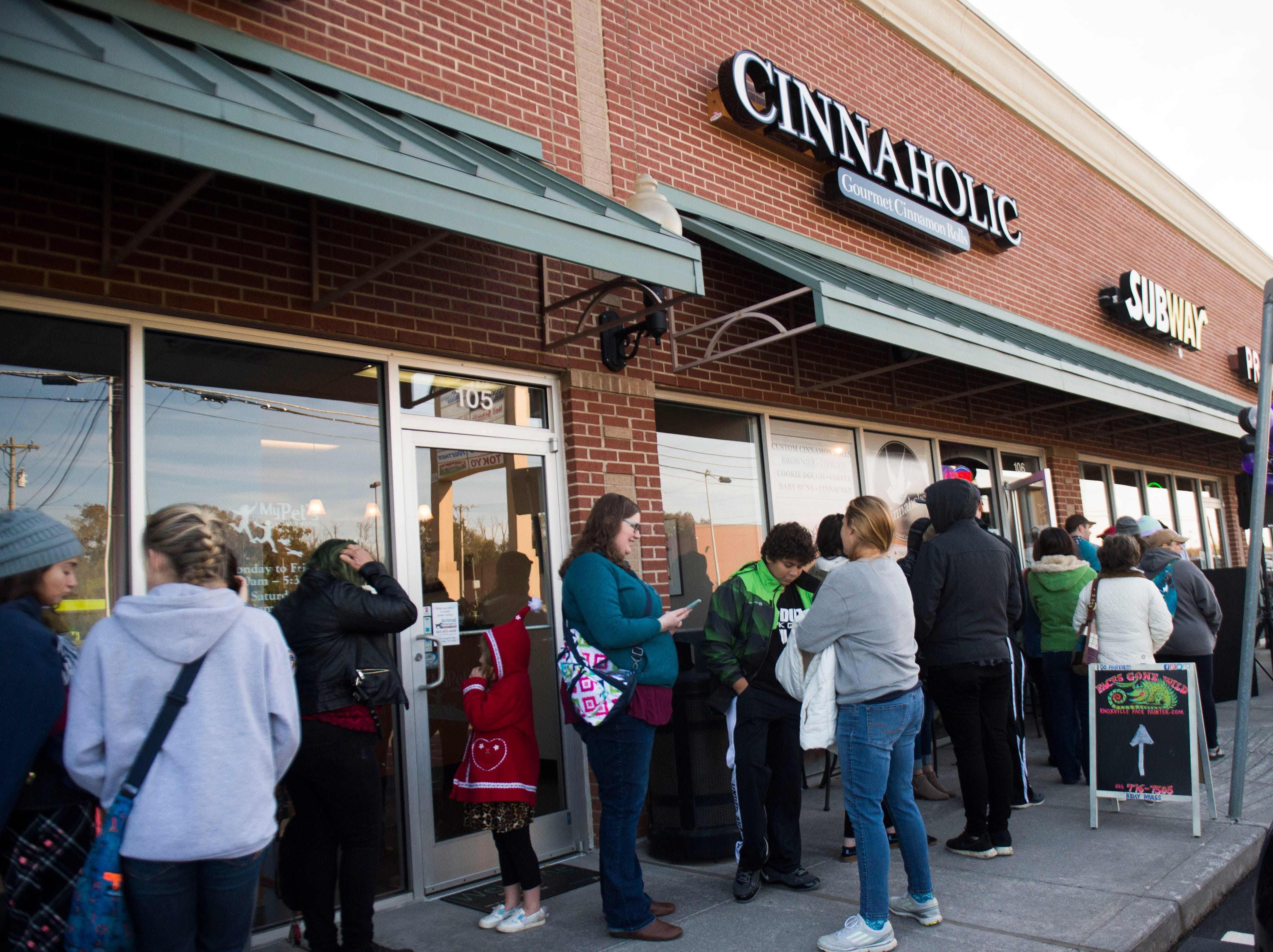 Patrons wait in line at Cinnaholic's grand opening at 9450 S. Northshore Drive Friday, Nov. 16, 2018. Cinnaholic is a vegan bake shop.