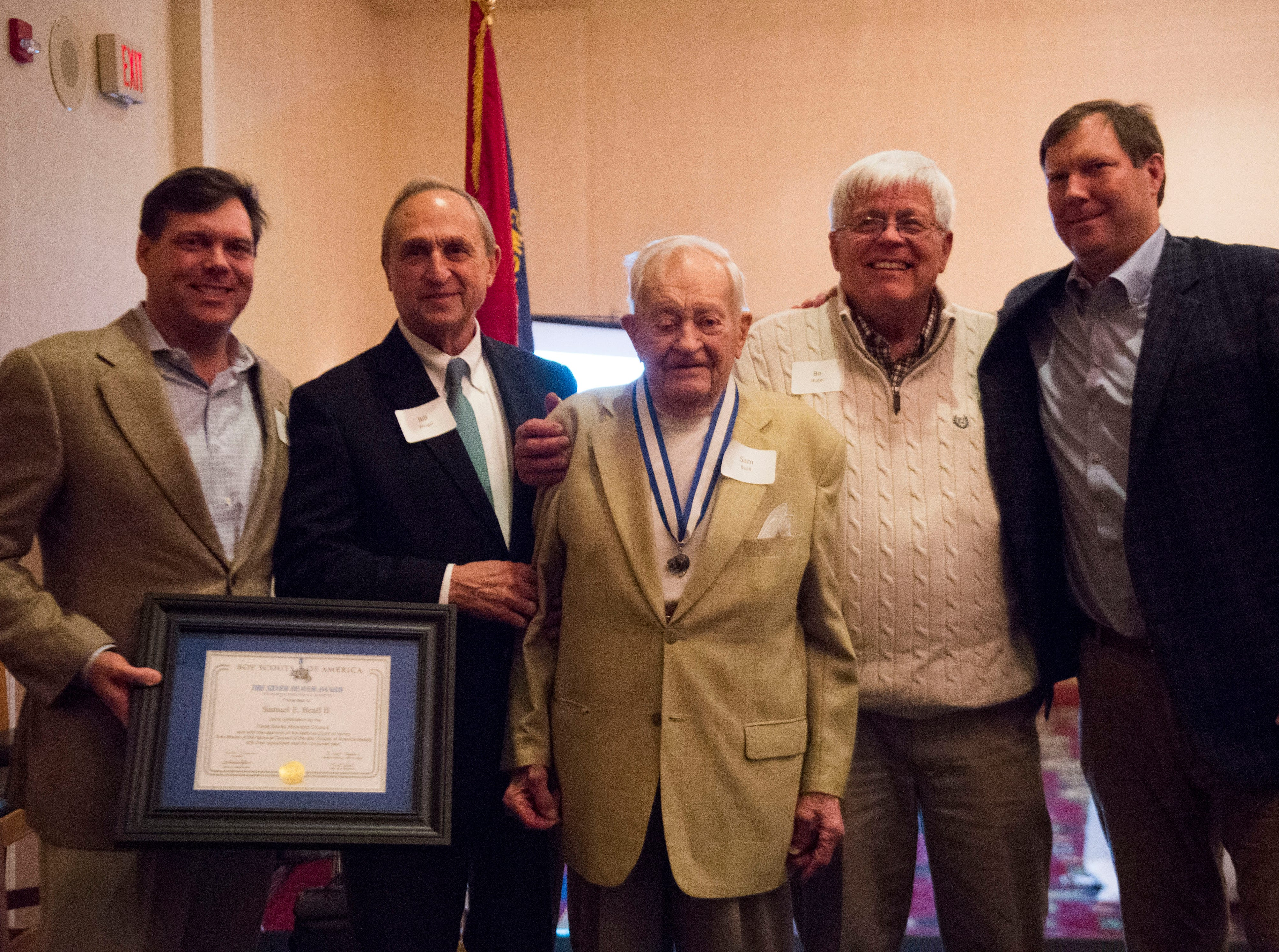 Second from left Bill Weigel, and Sam Beall, amongst others, pose for a photo after Beall was presented the Silver Beaver award at the 2018 Eagle Scout gathering held at Hotel Knoxville Thursday, Nov. 15, 2018.