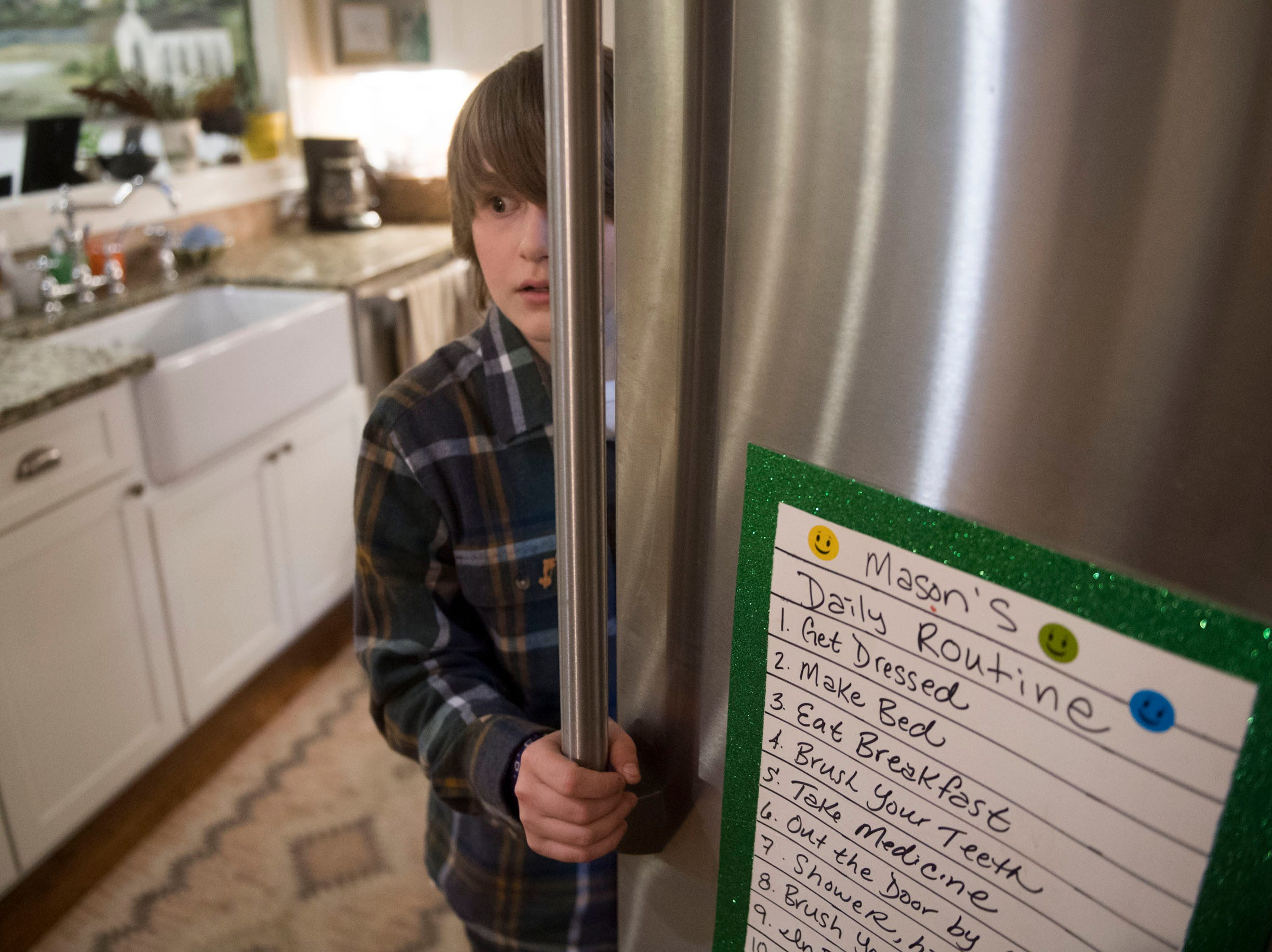 Mason Hall's daily routine is listed on the refrigerator.