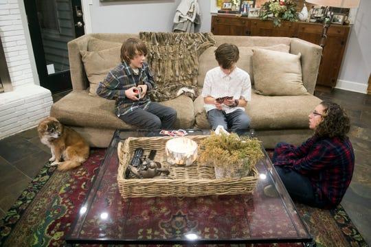 Mason, Blake and Lexi Hall play a game of UNO.