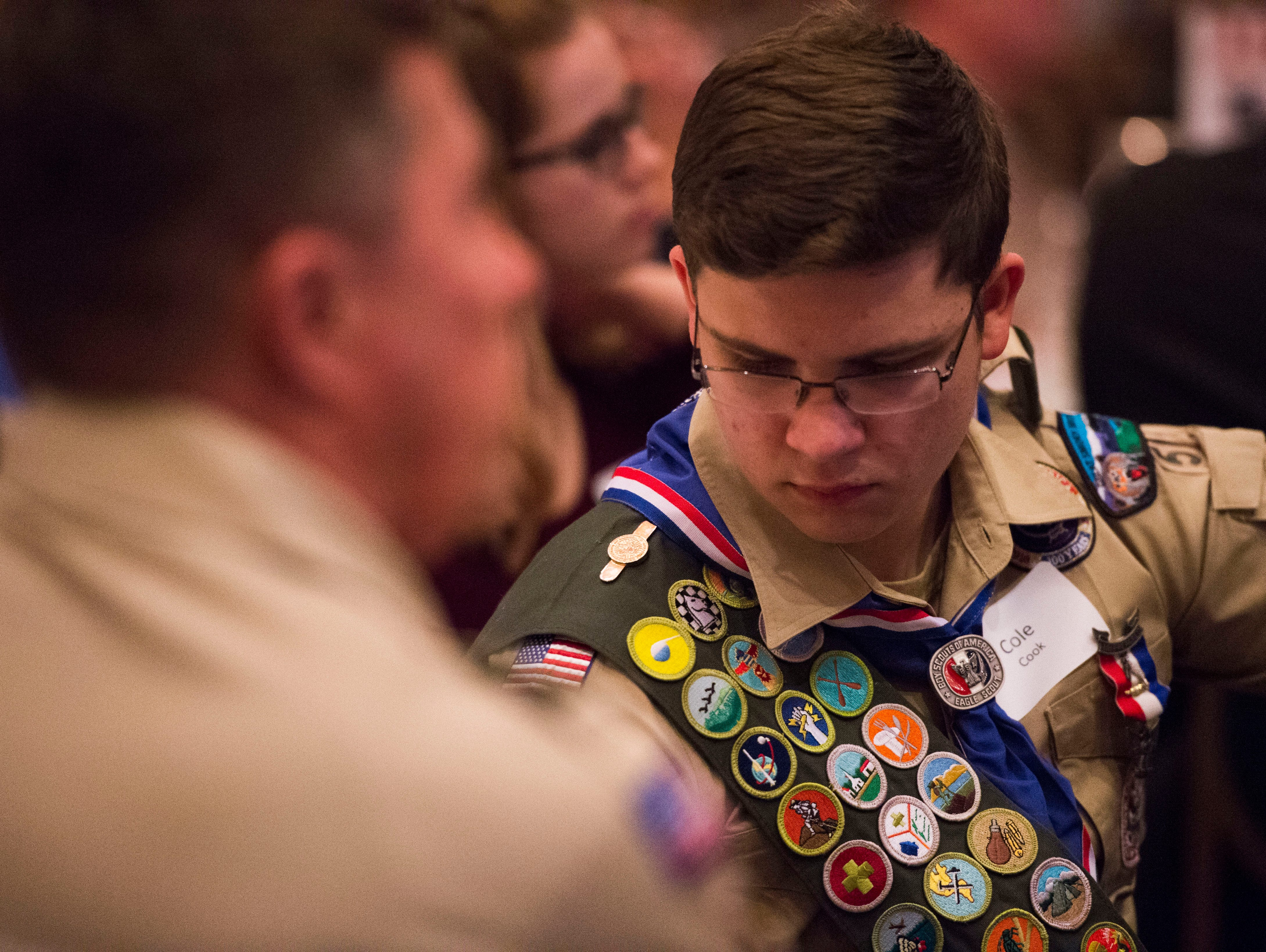 A decorated scout sits at the 2018 Eagle Scout gathering held at Hotel Knoxville Thursday, Nov. 15, 2018. Sam Beall received the Silver Beaver award, which is the highest award in scouting.