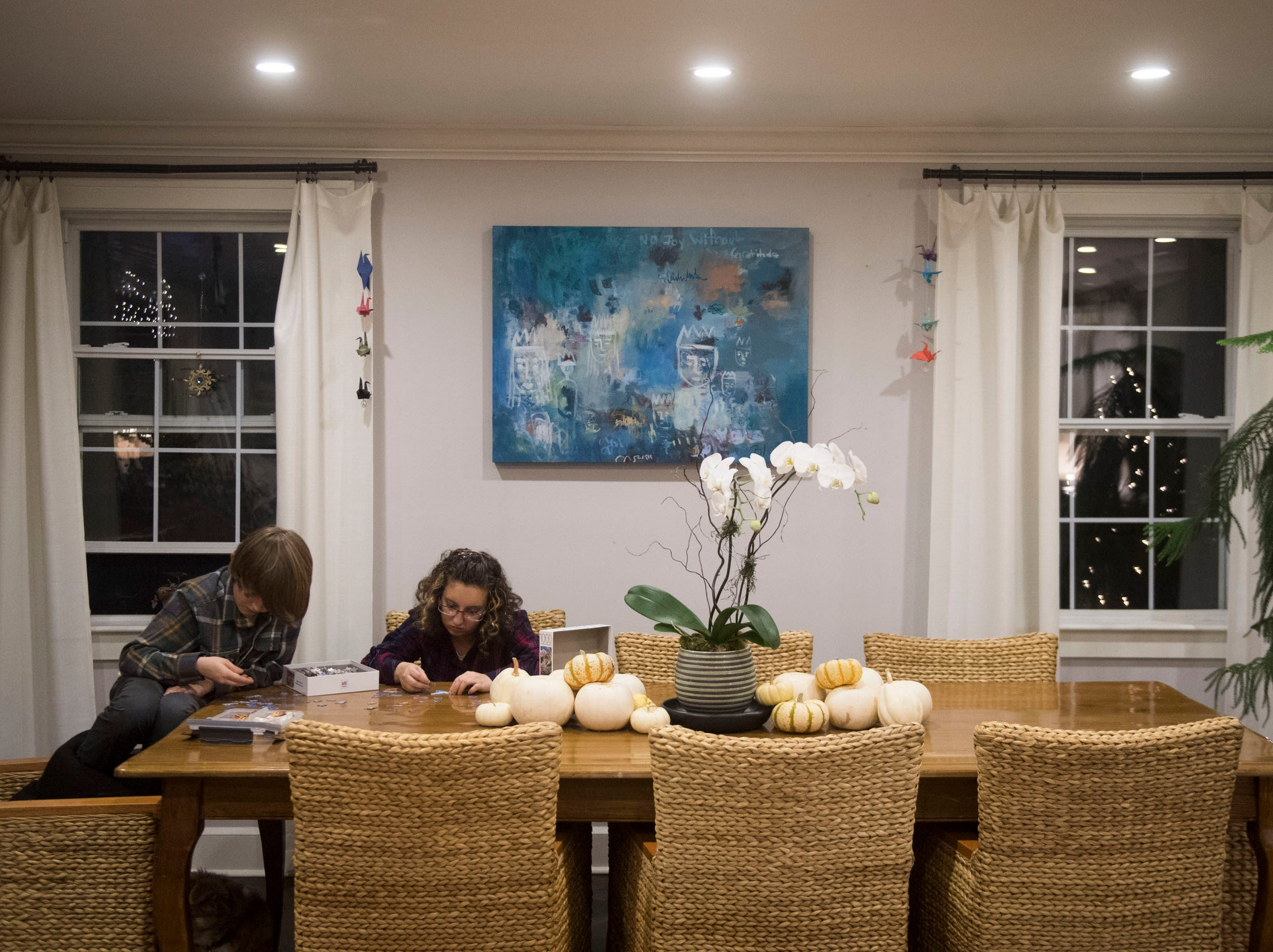 Mason and Alexis Hall put together a jigsaw puzzle in the dining room.
