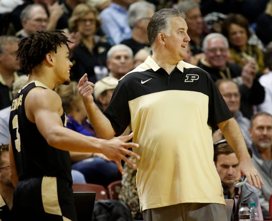 Purdue coach Matt Painter, right, stands next to Casen Edwards during the second half against Appalachian State in an NCAA college basketball game at the Charleston Classic on Thursday, Nov. 15, 2018, in Charleston, S.C. (AP Photo/Mic Smith)