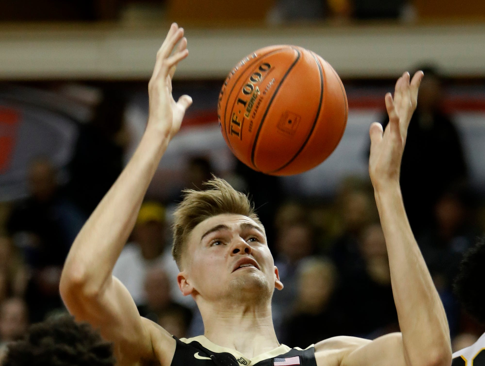 Purdue's Matt Haarms, center, grabs a rebound in front of Appalachian State's Joseph Battle, left, during the first half of an NCAA college basketball game at the Charleston Classic on Thursday, Nov. 15, 2018, in Charleston, S.C. (AP Photo/Mic Smith)