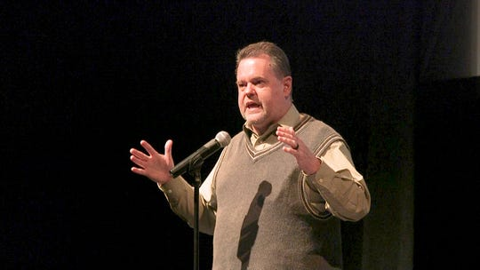 Kevin Foote tells a story during Lafayette Storytellers: Food and family.
