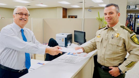 Lafayette Parish Sheriff Mark Garber files a covenant with Clerk of Court Louis Perret regarding the Dec. 8, 2018, tax proposal.
