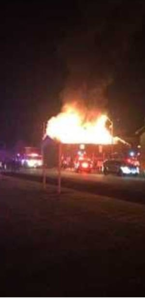 A fire completely destroyed an apartment building in Scott early Friday, displacing 22 residents.