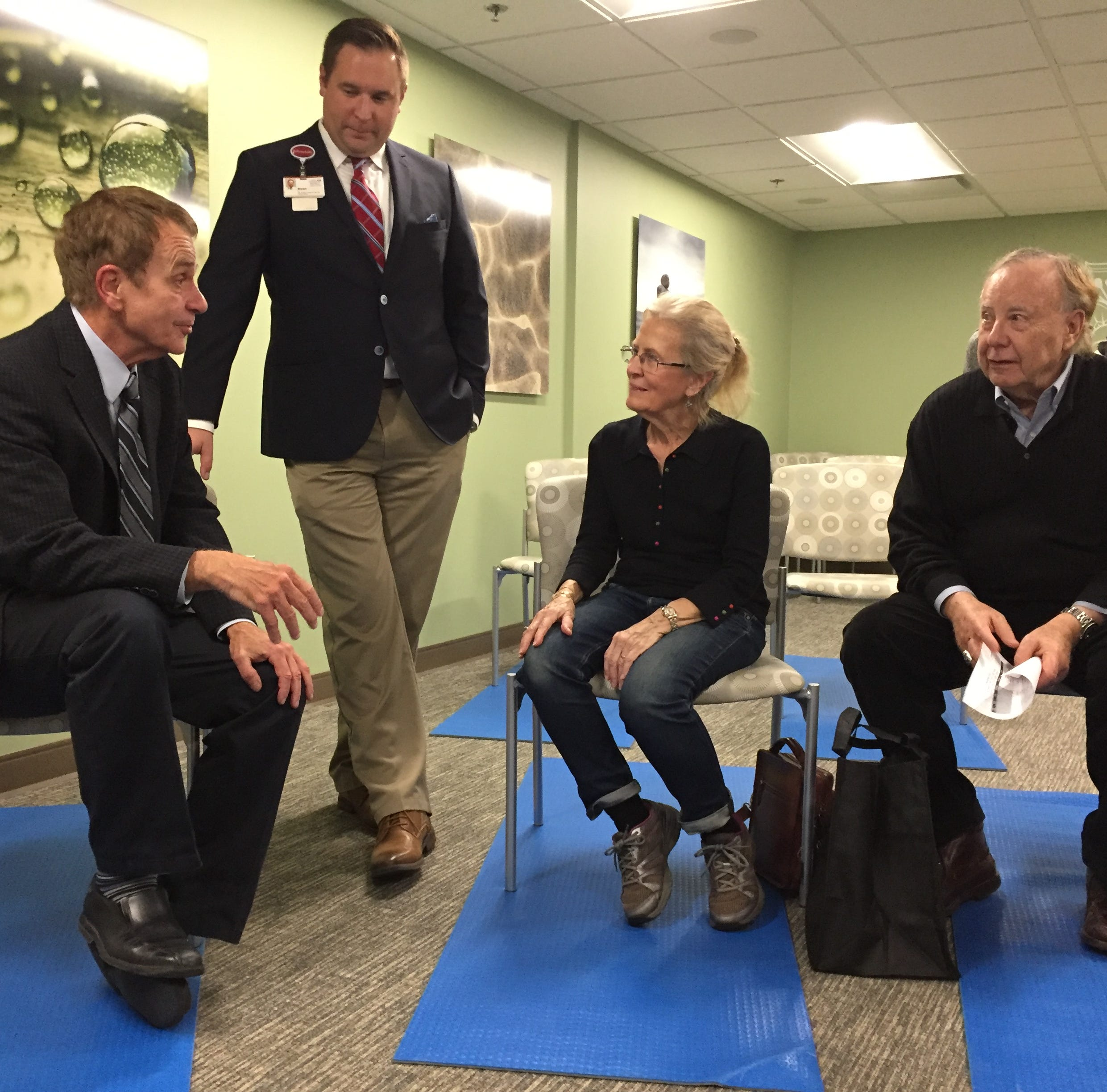 From left, Dr. Frank Smith, St. Joseph Mercy Ann Arbor and Livingston 's medical director of Intensive Cardiac Rehabilitation, and cardiac rehab manager Bryan Foster speak with potential cardiac rehab program patients Les and Jackie Stiner in the hospital's new yoga studio, Thursday, Nov. 15, 2018.