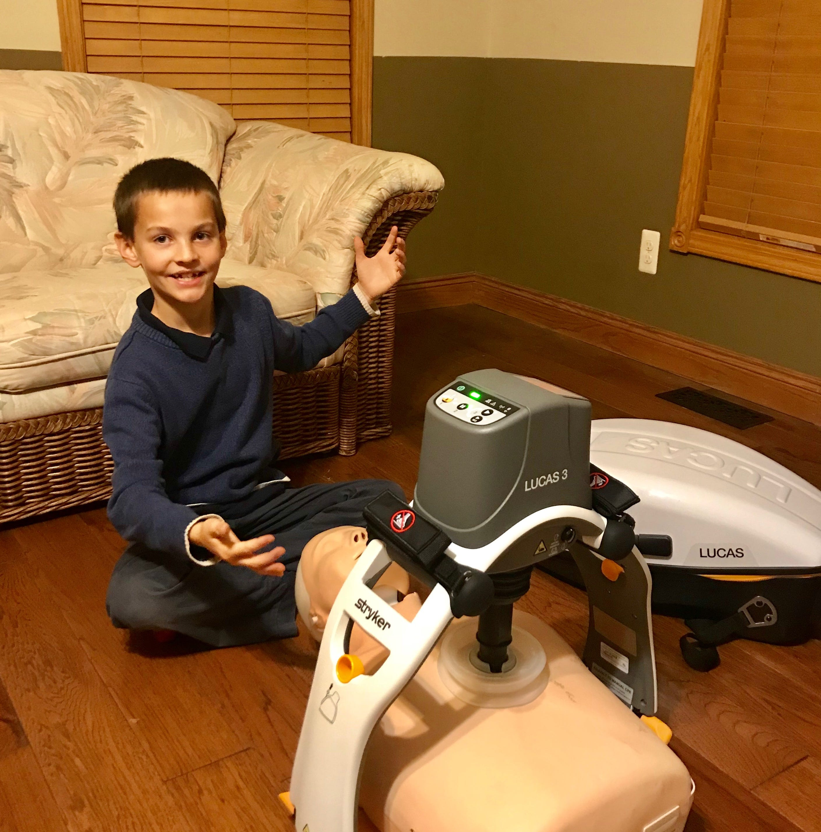 Lucas Vetter, 9, from Rose Township in Oakland County, shows off a LUCAS CPR machine donated to him to showcase as part of presentations he is giving to help raise money for the Howell Area Fire Department to buy another of the machines.