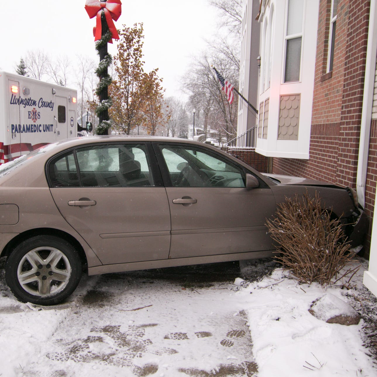 """A female driver of this Chevy Malibu was """"shaken up"""" but not seriously injured, according to Howell police, after crashing into the Bankers Square Condos building Friday, Nov. 16, 2018."""