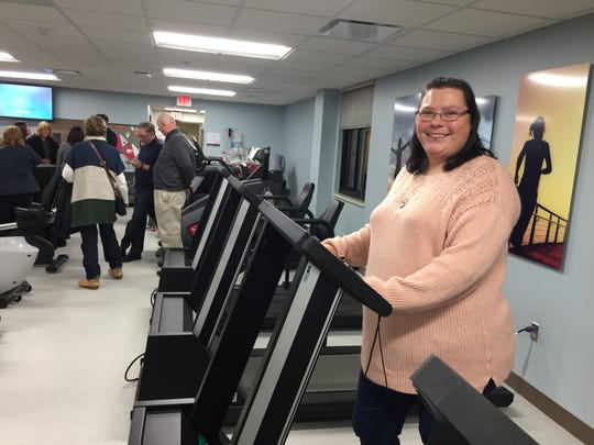 Cardiac rehab patient Amanda Kozdron steps onto a treadmill at St. Joseph Mercy Livingston's newly renovated gym in the hospital's Intensive Cardiac Rehabilitation Program center at an open house event, Thursday, Nov. 15, 2018.