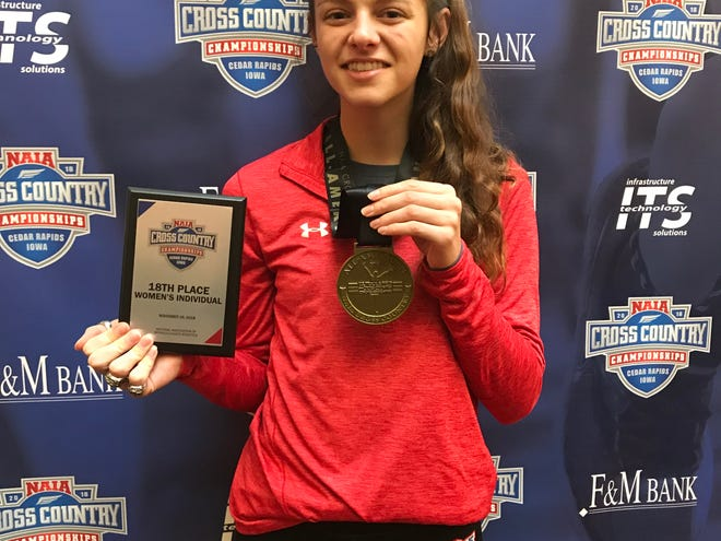 Cleary University's Madison Paquette earned All-America by placing 18th in the NAIA cross country meet.