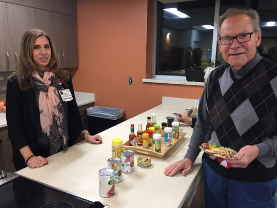St. Joseph Mercy Livingston dietitian Cristina Hauncher shows cardiac rehab program patient Lyle Albrant the new kitchen at the hospital's Intensive Cardiac Rehabilitation program center, Thursday, Nov. 15, 2018.