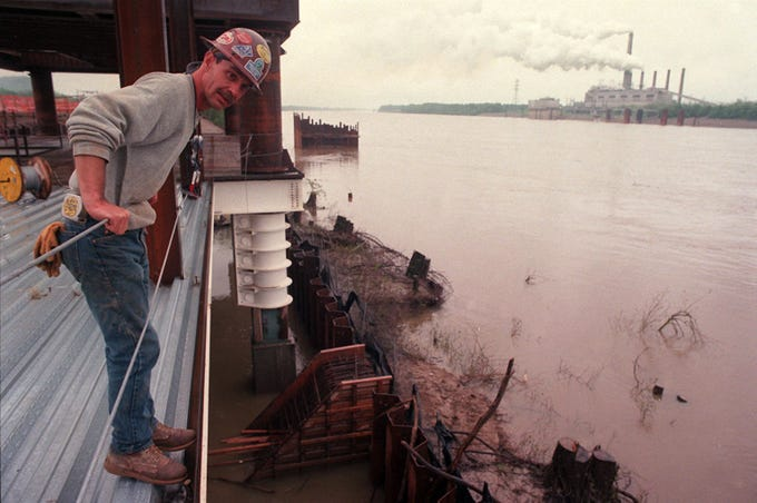 Ronnie Mattingly, general foreman and a member of Ironworkers Local #70 out of Louisville, looked over the side toward the Ohio River. He was standing on part of the main access ramp. Due to the rain not much work was going on. This is at Caesar's construction site on the Ohio River.