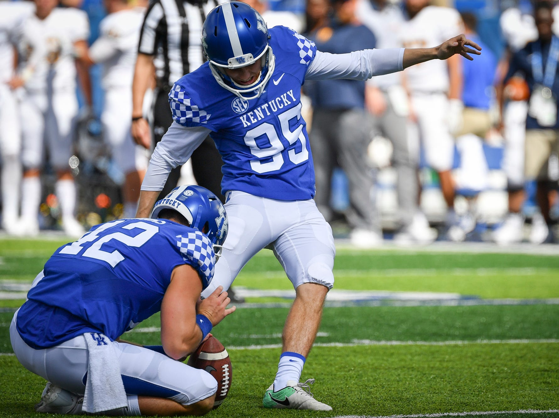 Kentucky Wildcats place kicker Miles Butler (95) kick a point after try during the first half an NCAA college football game against Murray State in Lexington, Ky., Saturday, Sept. 15, 2018.