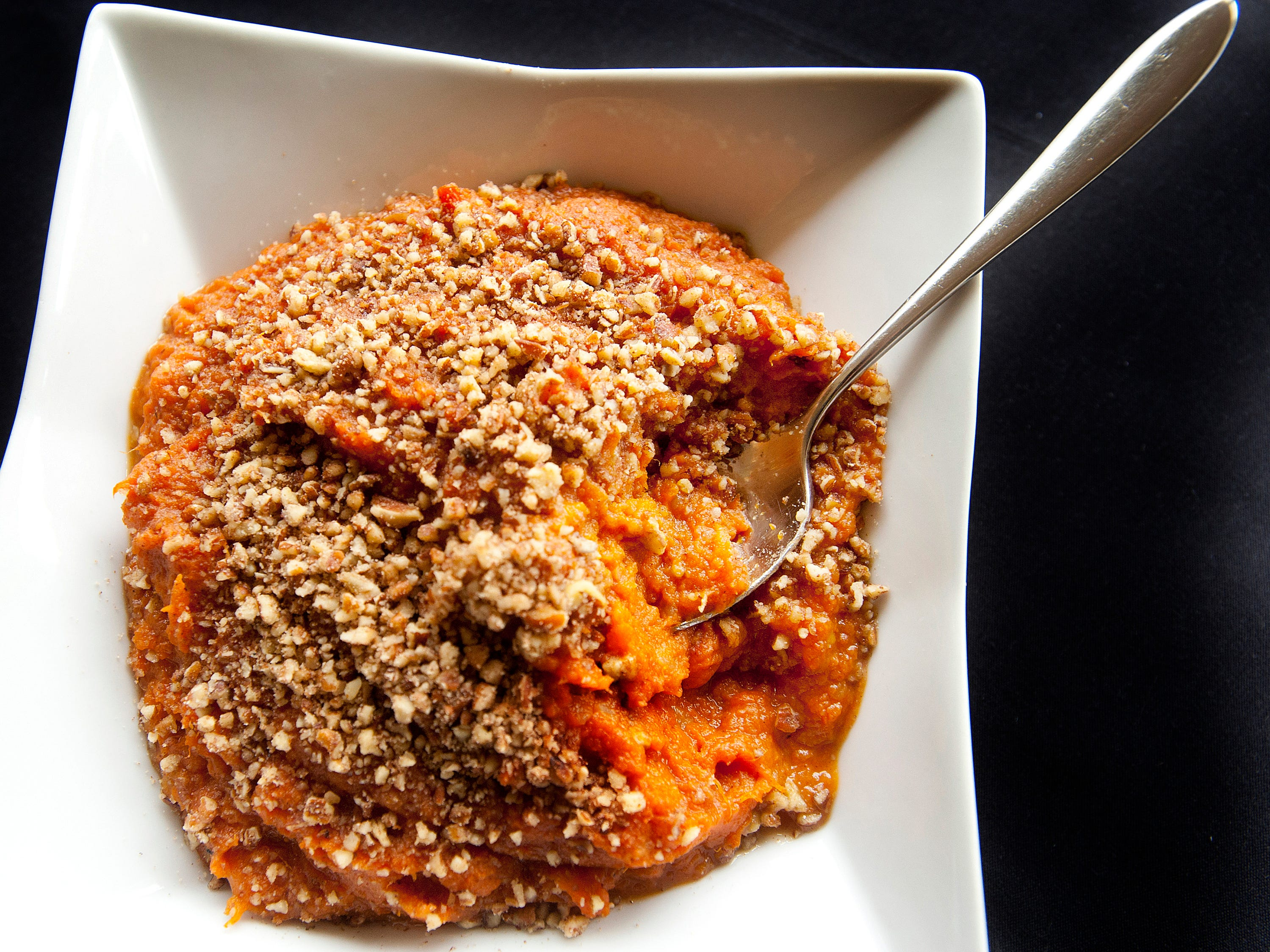 Varanese restaurant owner and executive chef John Varanese's Amaretto Sweet Potato Casserole is made with sweet potatoes flavored with Amaretto, white potatoes, butter, brown sugar, molasses, cinnamon and nutmeg. November 14, 2018