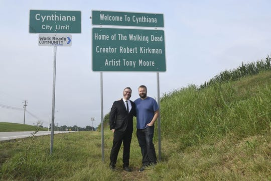 "Kentucky natives and ""The Walking Dead"" co-creators Tony Moore, left, and Robert Kirkman are pictured in August 2016 during a road sign dedication in their hometown, Cynthiana."