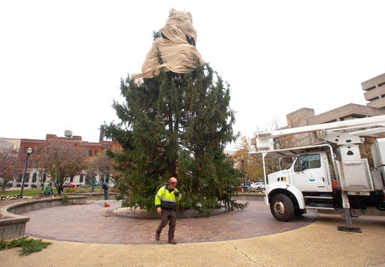 With the tree locked in place, workers leave the center of the park.November 14, 2019