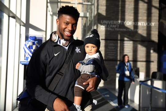 UK star outside linebacker Josh Allen poses with son, Wesley, at the UK training facility