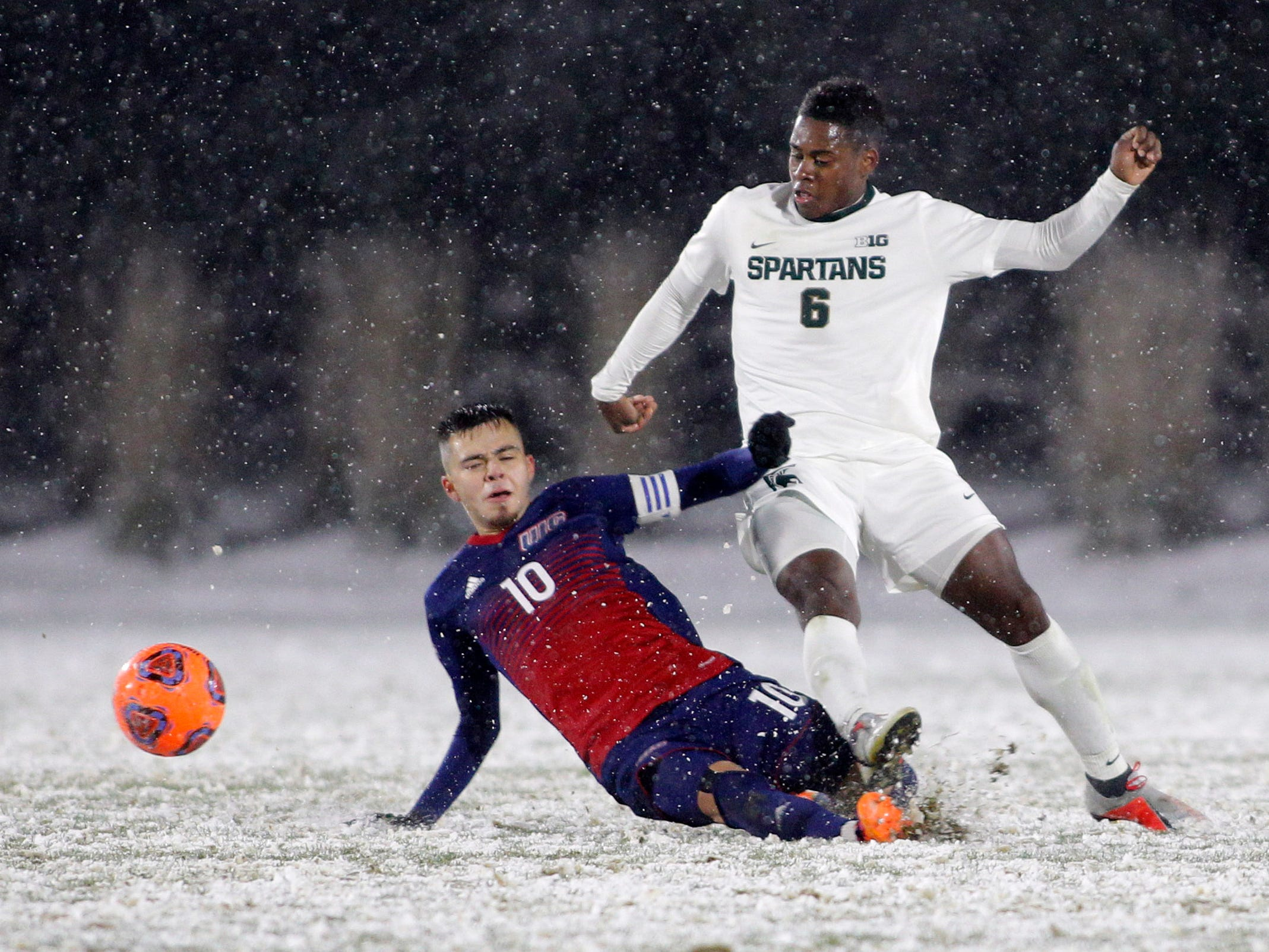 Michigan State's DeJuan Jones, right, is undercut by Illinois-Chicago's Nestor Garcia during their NCAA first round game, Thursday, Nov. 15, 2018, at DeMartin Stadium in East Lansing, Mich. MSU won 2-0.