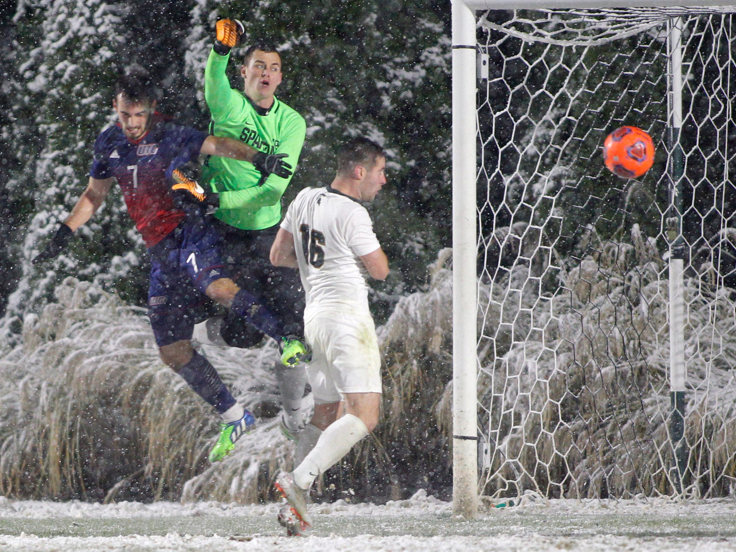Illinois-Chicago's Max Todd, left, and Michigan State's Connor Corrigan (16) and goalkeeper Jimmy Hague battle near the goal during their NCAA first round game, Thursday, Nov. 15, 2018, at DeMartin Stadium in East Lansing, Mich. MSU won 2-0.