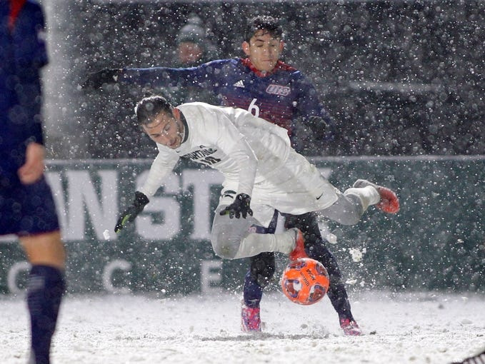 Michigan State's Giuseppe Barone is tripped by Illinois-Chicago's Nestor Garcia, rear, during their NCAA first round game, Thursday, Nov. 15, 2018, at DeMartin Stadium in East Lansing, Mich. MSU won 2-0.