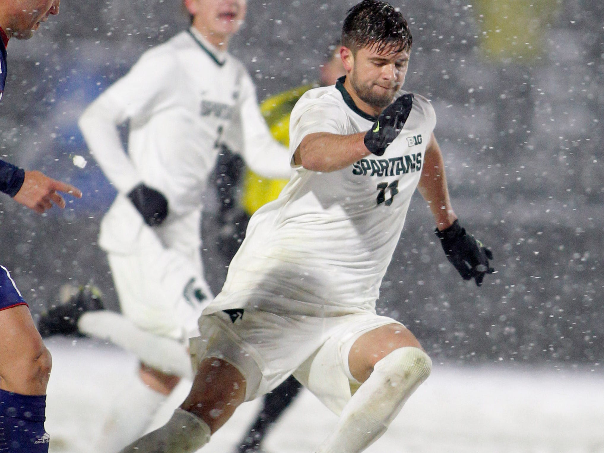 Michigan State's Ryan Sierakowski, right, pushes the ball against Illinois-Chicago during their NCAA first round game, Thursday, Nov. 15, 2018, at DeMartin Stadium in East Lansing, Mich. MSU won 2-0.