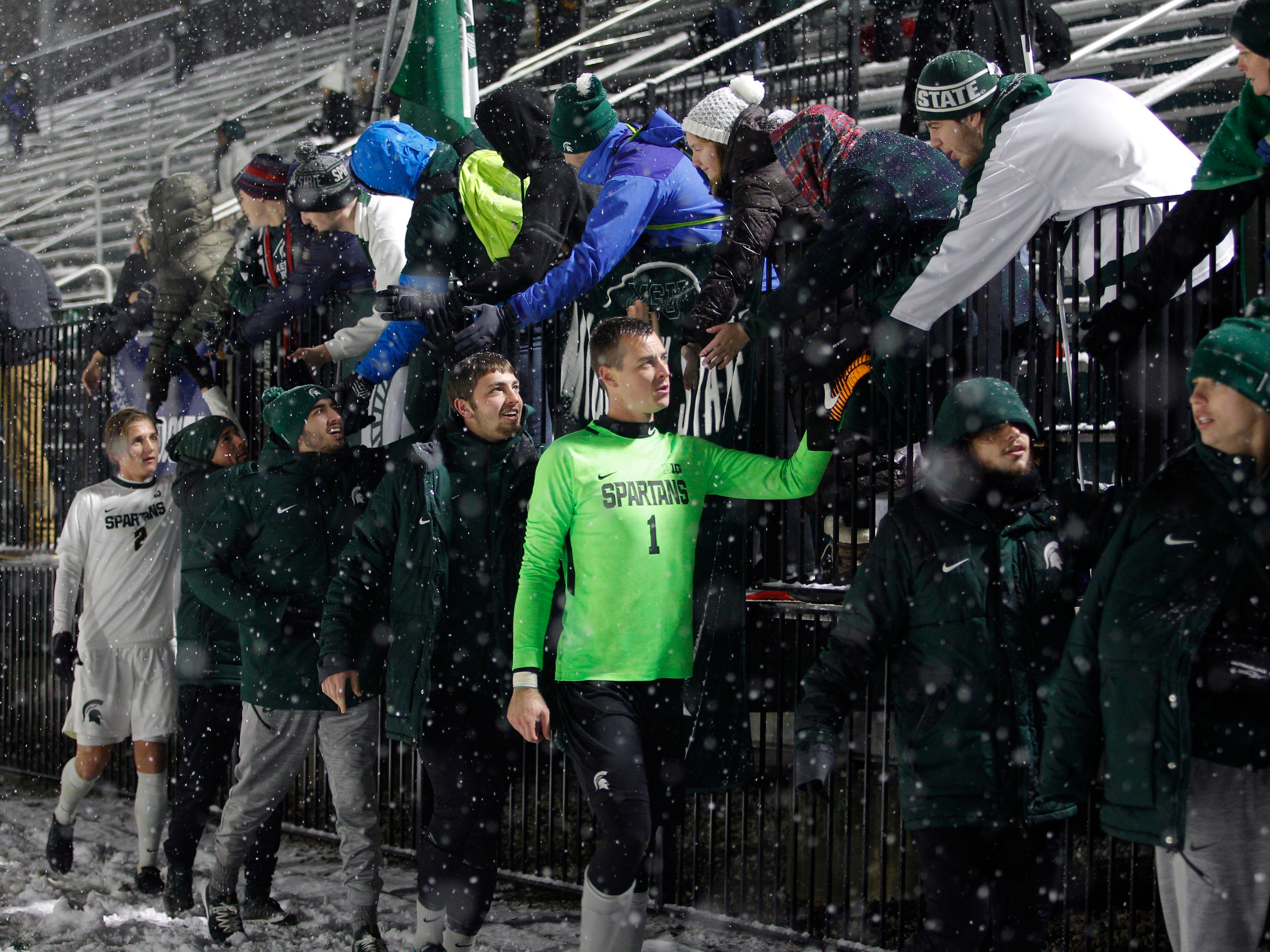 Michigan State players, including goalkeeper Jimmy Hague (1) greet fans following a 2-0 win over Illinois-Chicago in their NCAA first round game, Thursday, Nov. 15, 2018, at DeMartin Stadium in East Lansing, Mich. MSU won 2-0.