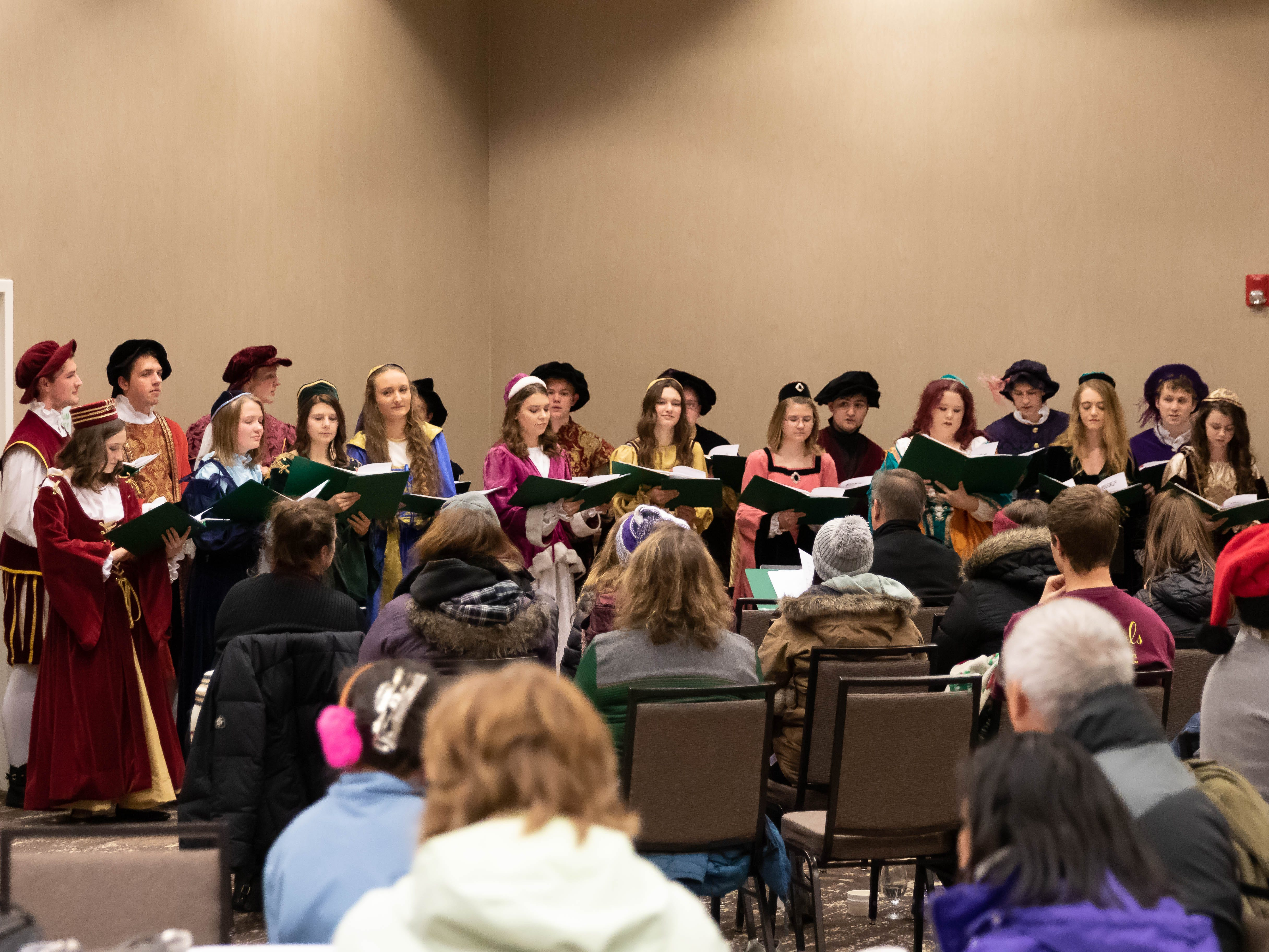 Students perform at the Holiday Inn after the Main Street Holiday Parade on Thursday, Nov. 15, 2018, in downtown Marshfield.