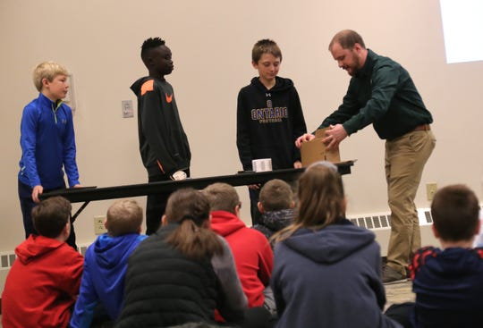 Representatives from MTD of Shelby show Ontario students how to assemble a product during a career day at Mid-Ohio Educational Service Center on Friday.