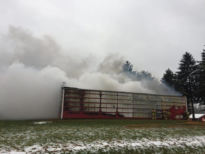Smoke rolls from a burning barn on Brubaker Creek Road on Friday, Nov. 16.
