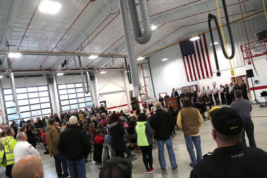 Shelby Mayor Steven Schag gives a speech in the new fire station on Friday.