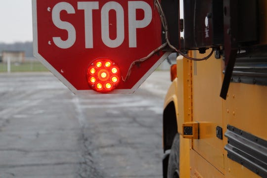 A Utah school district is praising two elementary school students who reported to a school bus driver that they'd found a handgun in a snow bank at their bus stop.