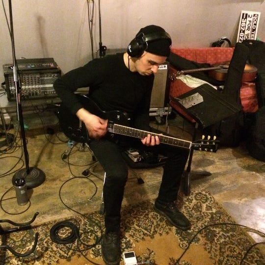 "Stephen Chopek in the studio working on ""Being the Glimmer."""
