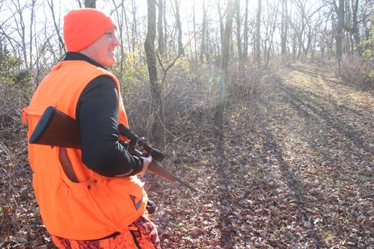 Kent Kramer of Dodgeville walks a path on his property before deer season. Kramer has allowed Department of Natural Resources researchers access to his property to conduct the Southwest Wisconsin CWD, Deer and Predator project.