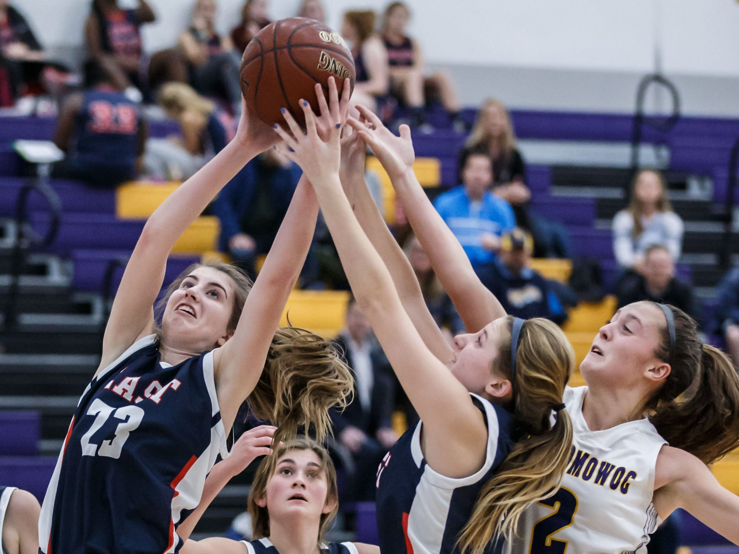 Brookfield East freshman Paige Platz (23) pulls down a rebound during the game at Oconomowoc on Thursday, Nov. 15, 2018.
