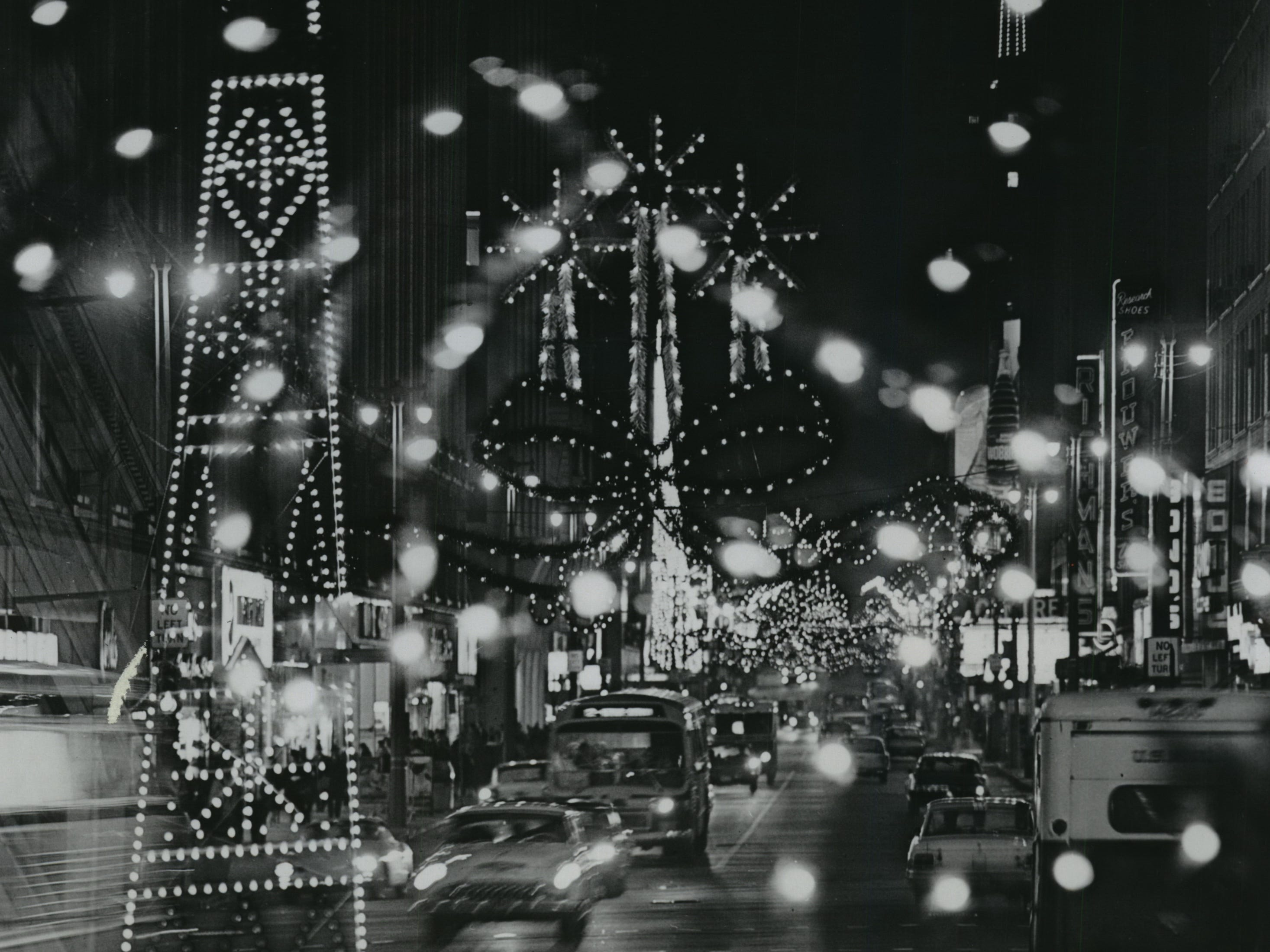 Wisconsin Avenue's lights get a double-exposure treatment in this photo taken during the Christmas shopping season in 1968.