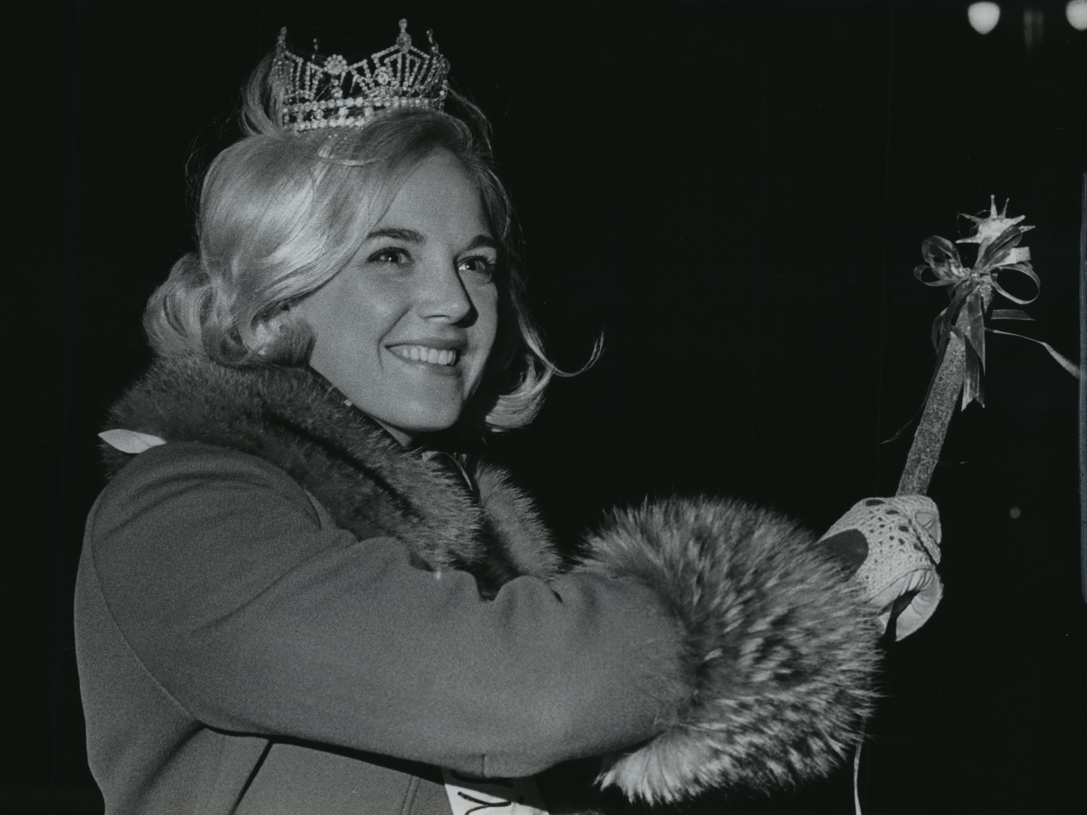 "With a wave of her ""wand,"" Miss Wisconsin Marilyn Kay Brahmsteadt turns on the lights of Milwaukee's Christmas displays along Wisconsin Avenue on Nov. 22, 1968. The light display, followed by the downtown Christmas parade the following day, formally kicked off the Christmas shopping season in Milwaukee. This photo was published in the Nov. 23, 1968, Milwaukee Journal."