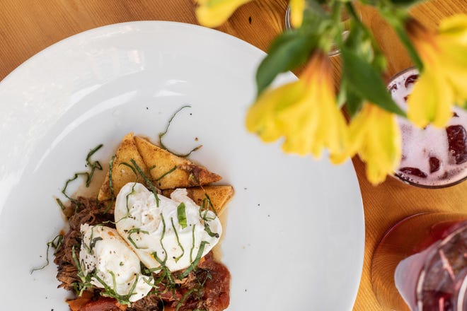 Seared polenta with bolognese and poached eggs is one of the dishes on the new brunch menu at Onesto, 221 N. Broadway