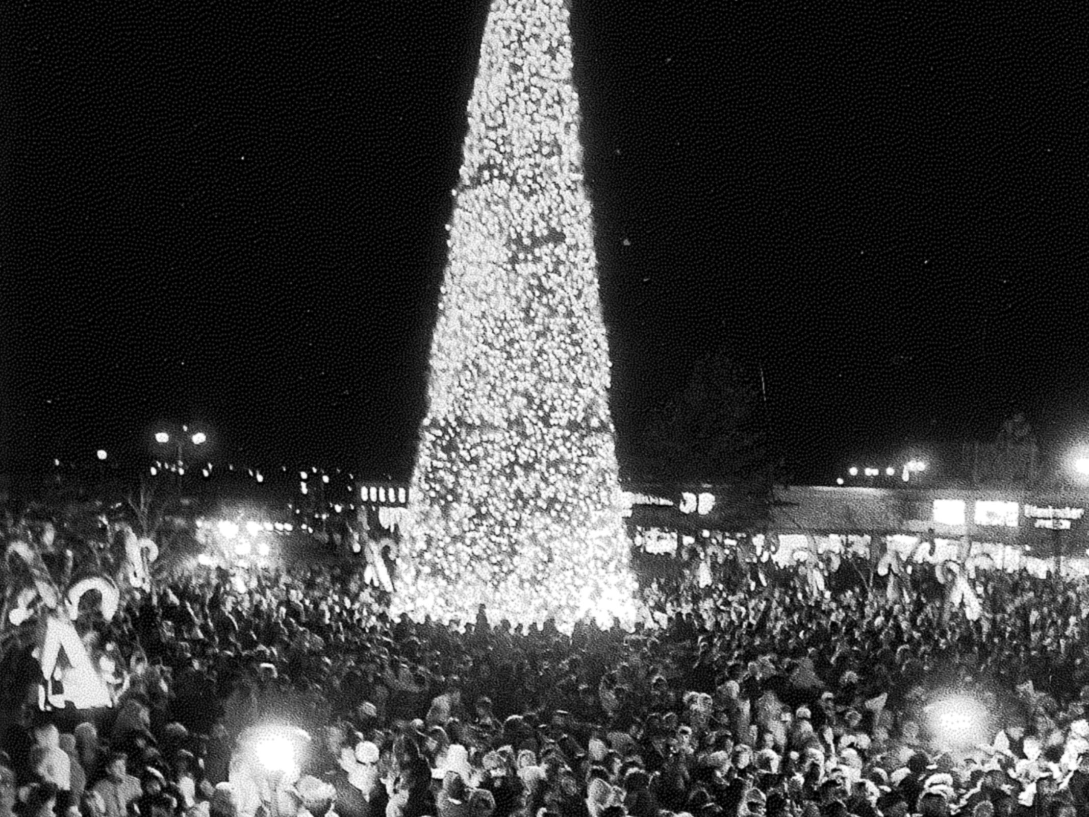 Crowds pack the square outside Capitol Court for the northwest side shopping center's annual tree lighting on Nov. 22, 1968. The 80-foot tree was festooned with more than 10,000 lights. This photo was published in the Nov. 23, 1968, Milwaukee Journal.