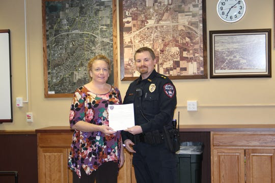 Hartland resident Jennifer Garton received a letter of appreciation from Police Chief Torin Misko after calling 911 when she saw an unresponsive man in a parked car.