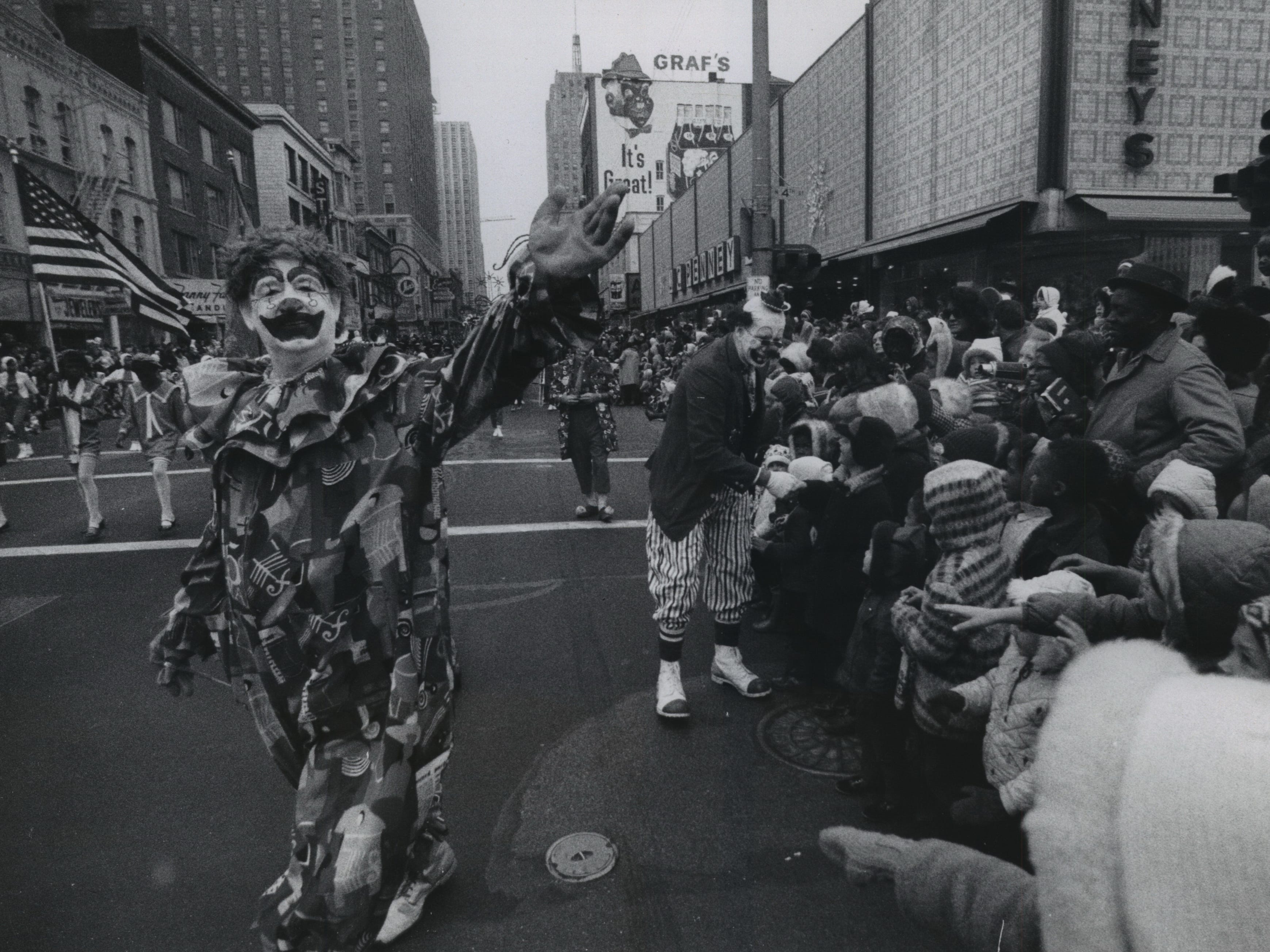 Clowns greet spectators along the route of Milwaukee's annual Christmas parade on Wisconsin Avenue at N. Fifth St. on Nov. 23, 1968. This photo was published on the front page of the Nov. 24, 1968, Milwaukee Journal.